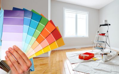 Professional man painter hand with colors. House renovation